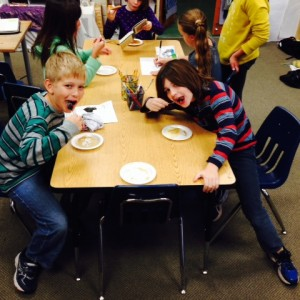 "These two are enjoying our class made ""moon cakes"" with pecan meteors!"